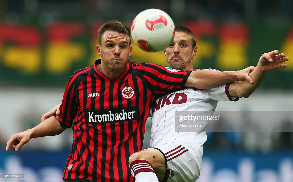<a gi-track='captionPersonalityLinkClicked' href=/galleries/search?phrase=Alexander+Meier&family=editorial&specificpeople=615512 ng-click='$event.stopPropagation()'>Alexander Meier</a> (L) of Frankfurt is challenged by Timmy Simons of Nuernberg during the Bundesliga match between Eintracht Frankfurt and 1. FC Nuernberg at Commerzbank-Arena on February 9, 2013 in Frankfurt am Main, Germany.