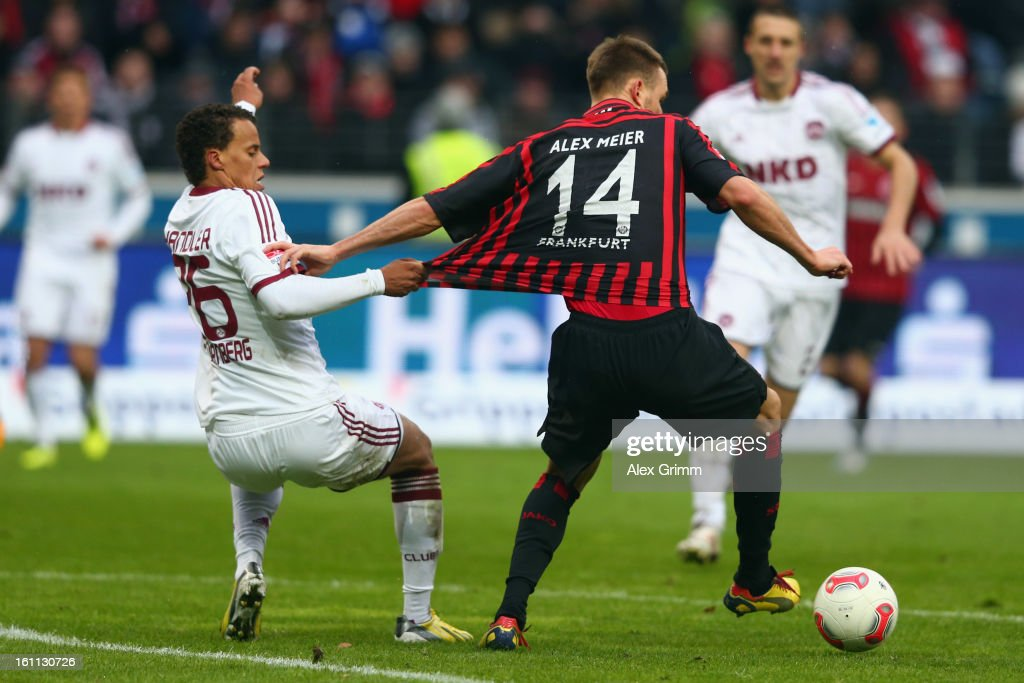 <a gi-track='captionPersonalityLinkClicked' href=/galleries/search?phrase=Alexander+Meier&family=editorial&specificpeople=615512 ng-click='$event.stopPropagation()'>Alexander Meier</a> (R) of Frankfurt is challenged by Timothy Chandler of Nuernberg during the Bundesliga match between Eintracht Frankfurt and 1. FC Nuernberg at Commerzbank-Arena on February 9, 2013 in Frankfurt am Main, Germany.