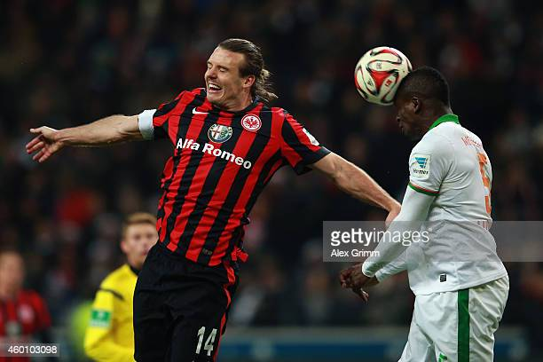 Alexander Meier of Frankfurt jumps for a header with Assani Lukimya of Bremen during the Bundesliga match between Eintracht Frankfurt and SV Werder...