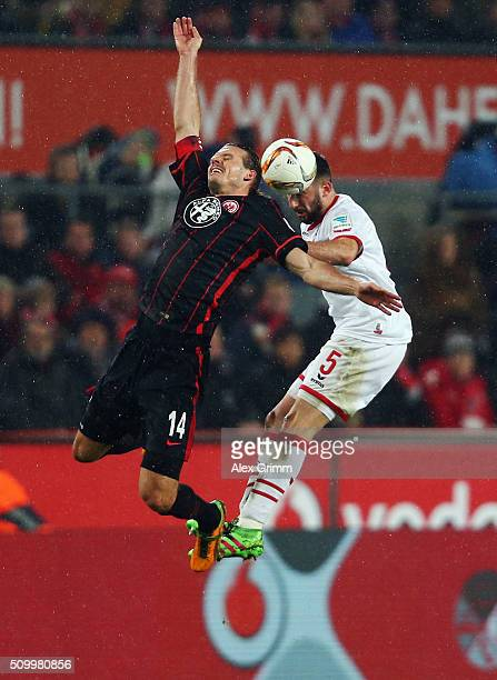 Alexander Meier of Frankfurt jumps for a header with Dominic Maroh of Koeln during the Bundesliga match between 1 FC Koeln and Eintracht Frankfurt at...