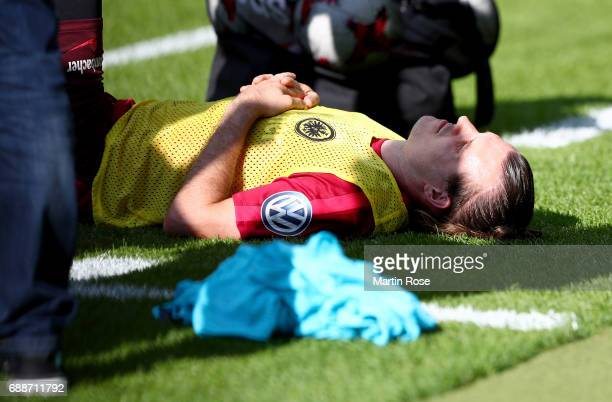 Alexander Meier of Frankfurt receives medical treatment during the Eintracht Frankfurt training session one day before the DFB Cup Final 2017 at...