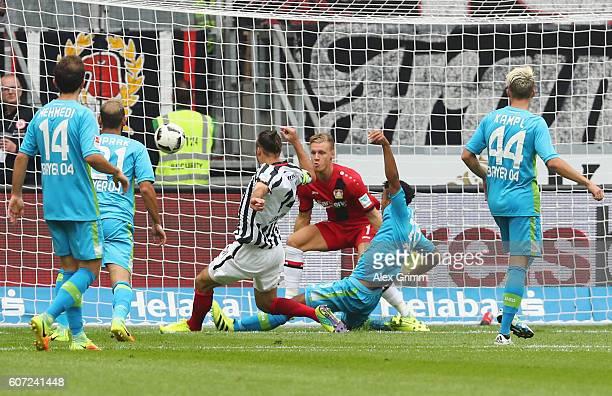 Alexander Meier of Frankfurt scores his team's first goal past goalkeeper Bernd Leno of Leverkusenduring the Bundesliga match between Eintracht...