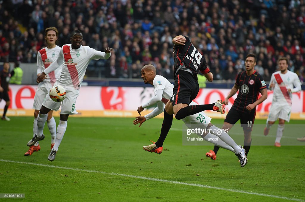 Alexander Meier of Frankfurt scores his team's first goal past Theodor Gebre Selassie of Bremen during the Bundesliga match between Eintracht...
