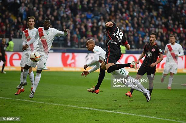 Alexander Meier of Frankfurt scores his team's first goal past Theodor Gebre Selassie of Bremen during the Bundesliga match between Eintracht...