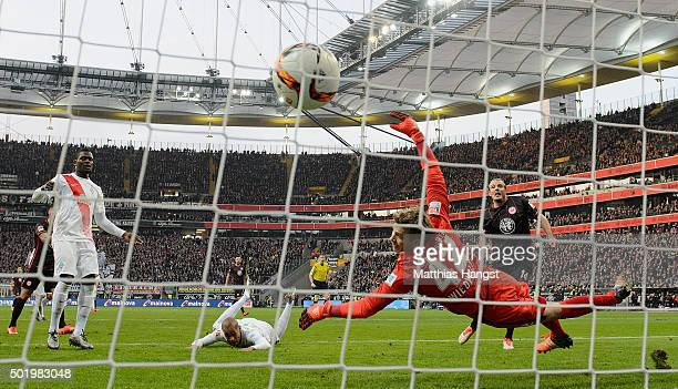 Alexander Meier of Frankfurt scores his team's first goal past Theodor Gebre Selassie of Bremen and goalkeeper Felix Wiedwald of Bremen during the...