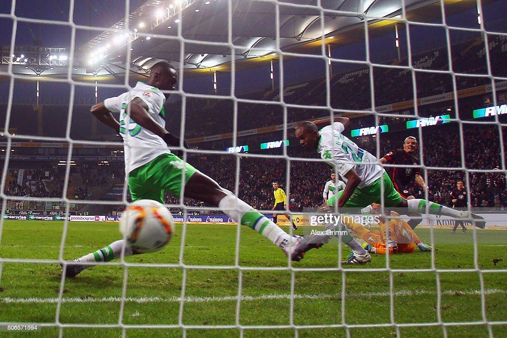 Alexander Meier of Frankfurt scores his team's second goal past goalkeeper Diego Benaglio Naldo and Josuha Guilavogui of Wolfsburg during the...