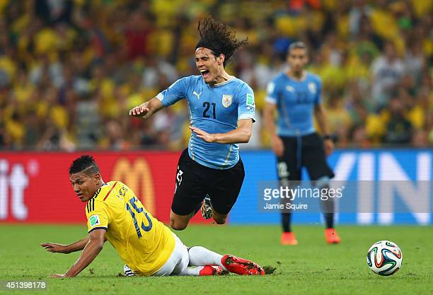 Alexander Mejia of Colombia tackles Edinson Cavani of Uruguay during the 2014 FIFA World Cup Brazil round of 16 match between Colombia and Uruguay at...