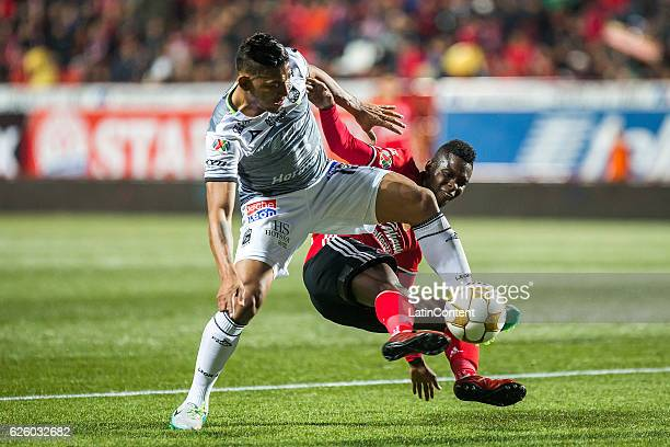 Alexander Mejia of Leon and Aviles Hurtado of Xolos vie for the ball during the quarter finals second leg match between Tijuana and Leon as part of...