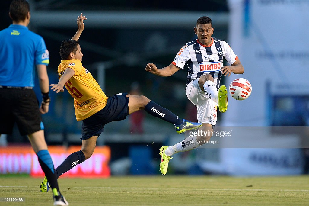 Alexander Mejia of Monterrey fights for the ball with <a gi-track='captionPersonalityLinkClicked' href=/galleries/search?phrase=Joel+Huiqui&family=editorial&specificpeople=875917 ng-click='$event.stopPropagation()'>Joel Huiqui</a> of Morelia during a match between Monterrey and Morelia as part of 15th round of Clausura 2015 Liga MX at Tecnologico Stadium, on April 25, 2015 in Monterrey, Mexico.