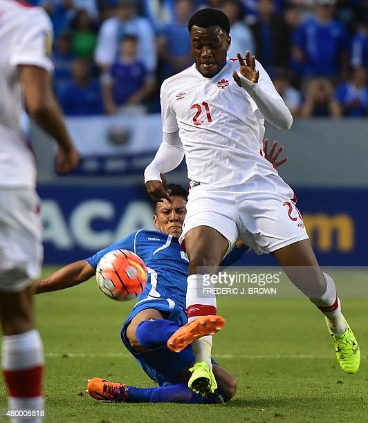 Alexander Mendoza of El Salvador fights for the ball with Cyle Larin of Canada during their 2015 Concacaf Gold Cup match in Carson California on July...