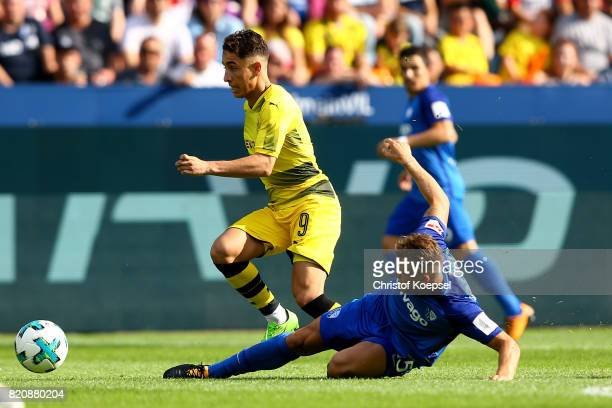 Alexander Merkel R challenges Emre Mor of Dortmund L during the preseason friendly match between VfL Bochum and Borussia Dortmund at Vonovia...