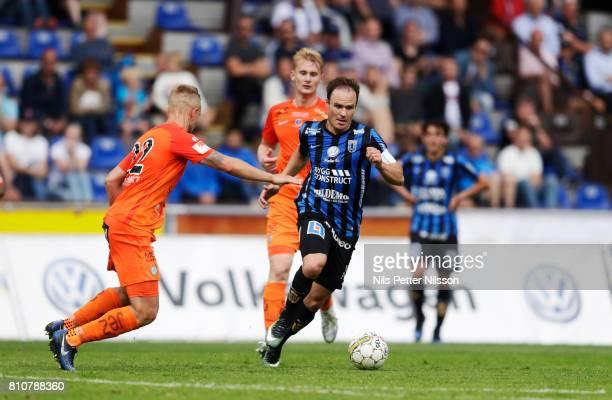 Alexander Michel of Athletic FC Eskilstuna and Niklas Busch Thor of IK Sirius FK competes for the ball during the Allsvenskan match between IK Sirius...