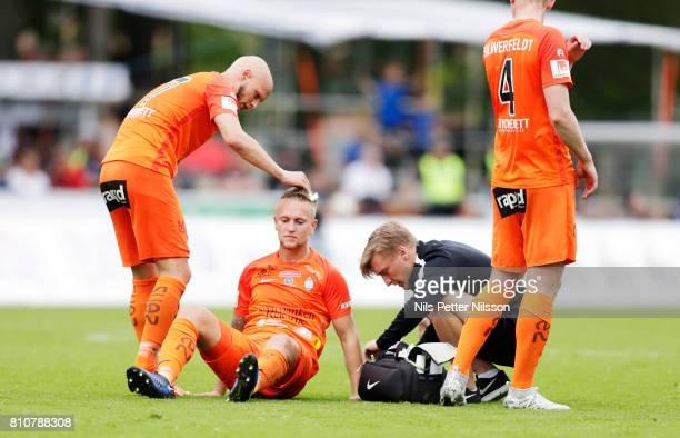 Alexander Michel of Athletic FC Eskilstuna injured during the Allsvenskan match between IK Sirius FK and Athletic FC Eskilstuna at Studenternas IP on...