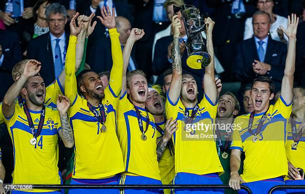 Alexander Milosevic of Sweden lifts up trophy with teammates after Swedish victory in UEFA U21 European Championship final match between Portugal and...
