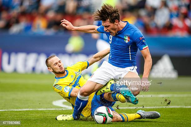Alexander Milosevic of Sweden tackles Andrea Belotti of Italy during the UEFA Under21 European Championship between Italy and Sweden at Andruv...