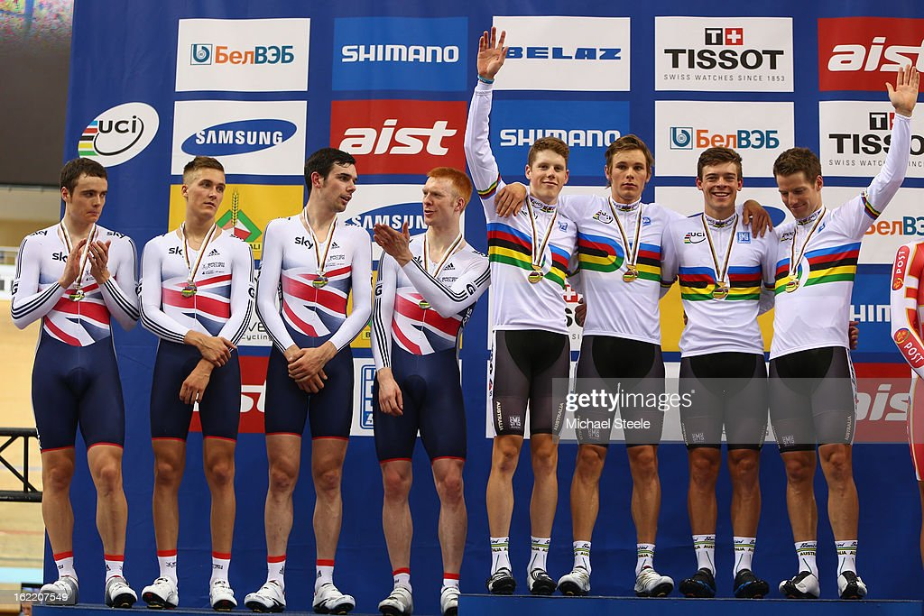 Alexander Morgan (L) , Michael Hepburn (2L) Alexander Edmondson (2R) and Glenn O'Shea (R) of Australia celebrate the men's team pursuit gold victory as the team of Great Britain with Ed Clancy,Andrew Tennant,Samuel Harrison and Samuel Harrison look on after claiming silver during day one of the UCI Track World Championships at Minsk Arena on February 20, 2013 in Minsk, Belarus.