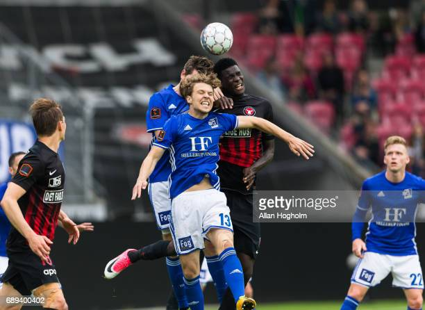 Alexander Munksgaard of Lyngby Boldklub and Paul Onuachu of FC Midtjylland compete for the ball during the Danish Alka Superliga match between FC...