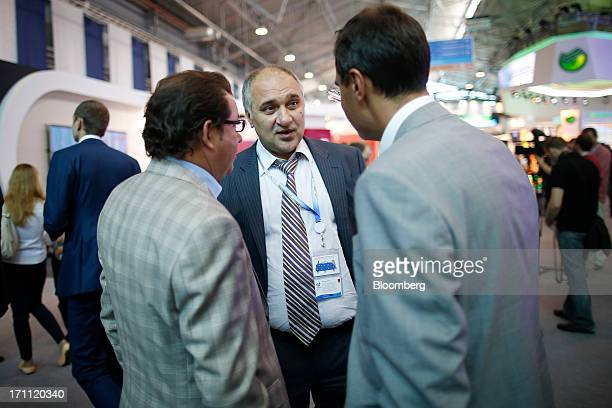 Alexander Nesis Russian billionaire and owner of ICT Group center talks to delegates as he moves between sessions on day two of the St Petersburg...