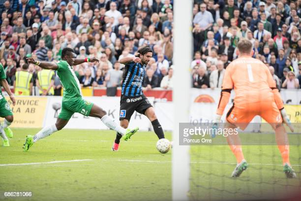 Alexander Nilsson of IK Sirius FK shoots and Joseph Aidoo of Hammarby IF try to make a save during the Allsvenskan match between IK Sirius FK and...