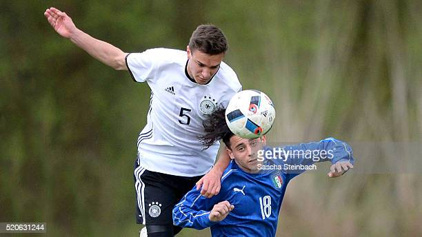 Alexander Nitzel of Germany and Davide Merola of Italy battle for a header during the U16 international friendly match between Germany and Italy at...