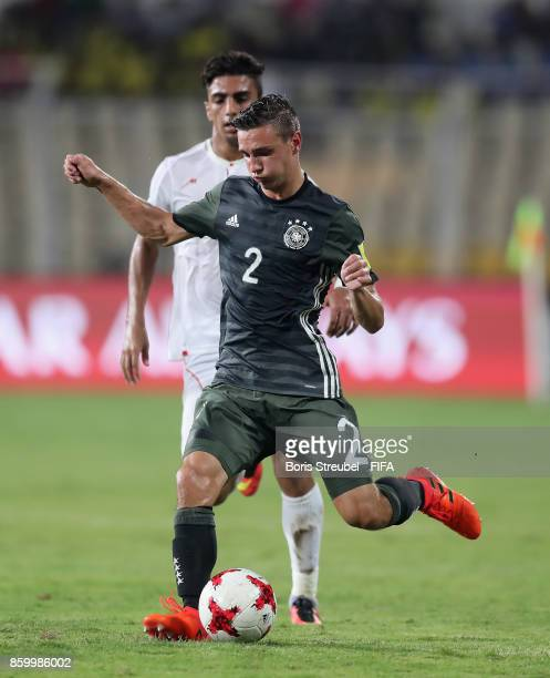 Alexander Nitzl of Germany is challenged by Younes Delfi of Iran during the FIFA U17 World Cup India 2017 group C match between Iran and Germany at...