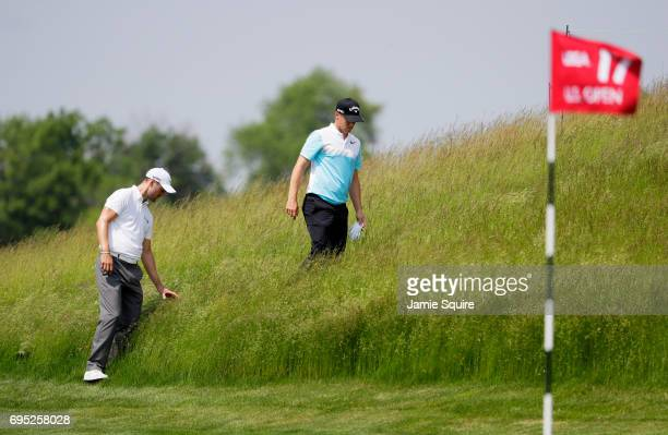 Alexander Noren of Sweden and Martin Kaymer of Germany look for a ball on the 17th hole during a practice round prior to the 2017 US Open at Erin...