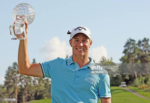 Alexander Noren of Sweden celebrates with the trophy after winning the final round of the Nordea Scandinavian Masters at Bro Hof Slott Golf Course on...