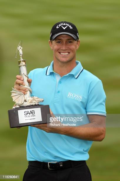 Alexander Noren of Sweden poses with the trophy after winning during the final round of the Saab Wales Open on the Twenty Ten course at The Celtic...