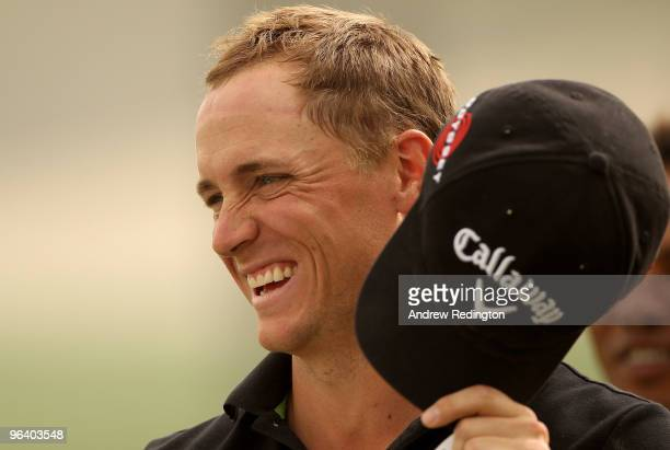 Alexander Noren of Sweden smiles after putting out on the ninth hole during the first round of the Omega Dubai Desert Classic on February 4 2010 in...