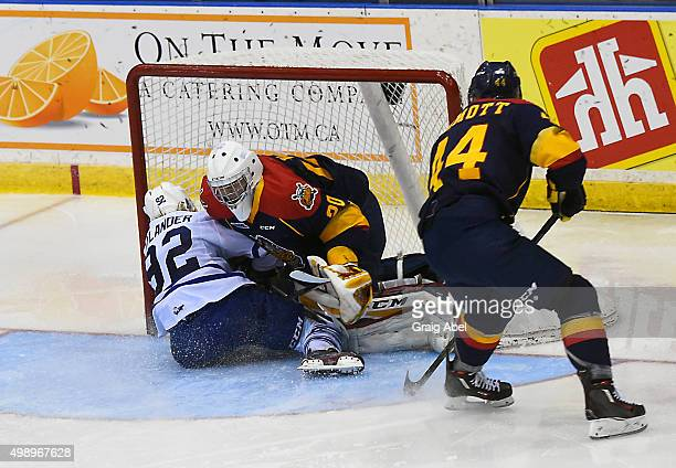 Alexander Nylander of the Mississauga Steelheads crashes into Jake Lawr of the Erie Otters during OHL game action on November 27 2015 at the Hershey...