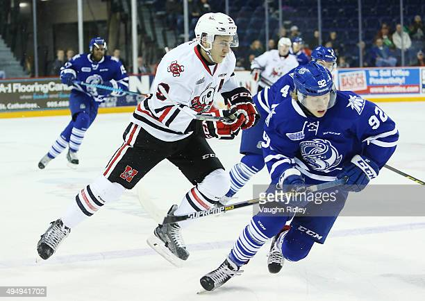 Alexander Nylander of the Mississauga Steelheads is chased up the ice by Jordan Maletta of the Niagara IceDogs during an OHL game at the Meridian...