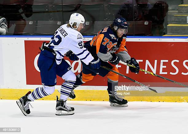 Alexander Nylander of the Mississauga Steelheads skates up ice against Jacob Collins of the Flint Firebirds during OHL game action on October 4 2015...