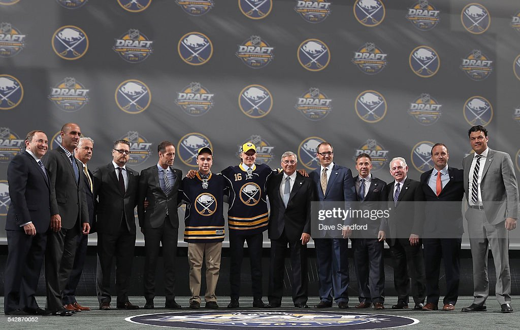 <a gi-track='captionPersonalityLinkClicked' href=/galleries/search?phrase=Alexander+Nylander&family=editorial&specificpeople=13713600 ng-click='$event.stopPropagation()'>Alexander Nylander</a> poses for a photo with the Buffalo Sabres team personnel after being selected eighth overall by the Buffalo Sabres during round one of the 2016 NHL Draft at First Niagara Center on June 24, 2016 in Buffalo, New York.