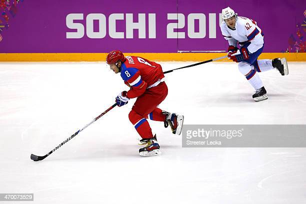 Alexander Ovechkin of Russia breaks away with the puck against Henrik Oedegaard of Norway during the Men's Ice Hockey Qualification Playoff game on...