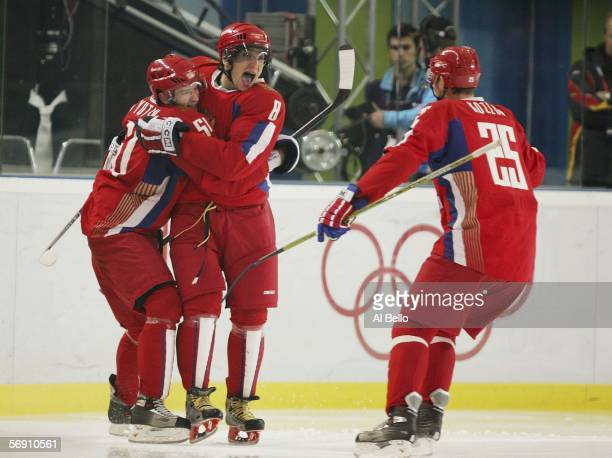 Alexander Ovechkin of Russia celebrates his third period goal to give Russia a 10 lead over Canada with teammates Fedor Tyutin and Viktor Kozlov...