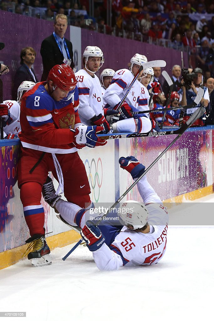 <a gi-track='captionPersonalityLinkClicked' href=/galleries/search?phrase=Alexander+Ovechkin&family=editorial&specificpeople=184488 ng-click='$event.stopPropagation()'>Alexander Ovechkin</a> #8 of Russia checks Olekristian Tollefsen #55 of Norway during the Men's Ice Hockey Qualification Playoff game on day eleven of the Sochi 2014 Winter Olympics at Bolshoy Ice Dome on February 18, 2014 in Sochi, Russia.