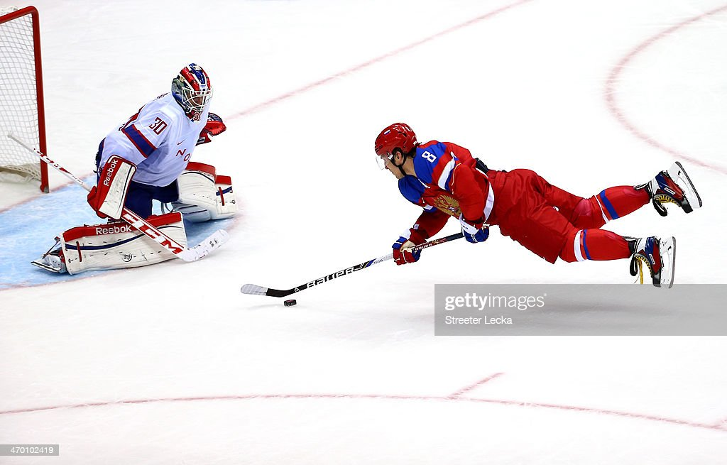 <a gi-track='captionPersonalityLinkClicked' href=/galleries/search?phrase=Alexander+Ovechkin&family=editorial&specificpeople=184488 ng-click='$event.stopPropagation()'>Alexander Ovechkin</a> #8 of Russia falls to the ice against <a gi-track='captionPersonalityLinkClicked' href=/galleries/search?phrase=Lars+Haugen&family=editorial&specificpeople=7718894 ng-click='$event.stopPropagation()'>Lars Haugen</a> #30 of Norway during the Men's Ice Hockey Qualification Playoff game on day eleven of the Sochi 2014 Winter Olympics at Bolshoy Ice Dome on February 18, 2014 in Sochi, Russia.