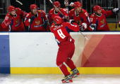 Alexander Ovechkin of Russia is congratulated by teammates after scoring a third period goal to give Russia a 30 lead over Canada during the quarter...