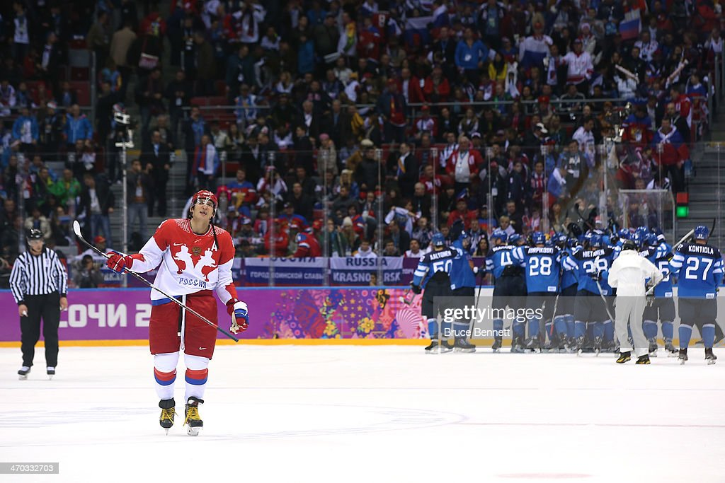 <a gi-track='captionPersonalityLinkClicked' href=/galleries/search?phrase=Alexander+Ovechkin&family=editorial&specificpeople=184488 ng-click='$event.stopPropagation()'>Alexander Ovechkin</a> #8 of Russia reacts after Finland beat Russia 3-1 during the Men's Ice Hockey Quarterfinal Playoff on Day 12 of the 2014 Sochi Winter Olympics at Bolshoy Ice Dome on February 19, 2014 in Sochi, Russia.