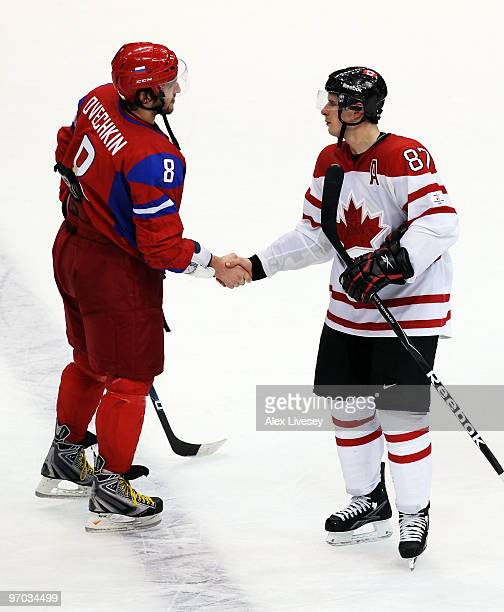 Alexander Ovechkin of Russia shakes hands with Sidney Crosby of Canada after Canada's 73 victory during the ice hockey men's quarter final game...
