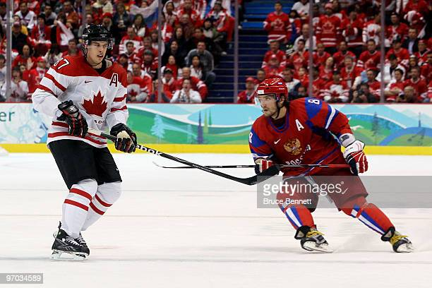 Alexander Ovechkin of Russia skates next to Sidney Crosby of Canada in the third period during the ice hockey men's quarter final game between Russia...