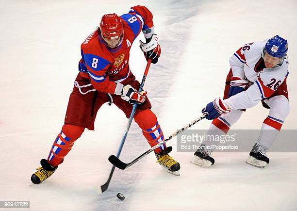 Alexander Ovechkin of Russia with Patrik Elias of the Czech Republic during the ice hockey men's preliminary game between Russia and Czech Republic...