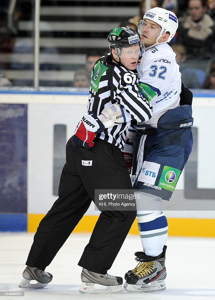 Alexander Ovechkin #32 of the Dinamo and referee Alexander Otmakhov after the fight during the game between Dinamo Moscow and Lokomotiv Yaroslavl during the KHL Championship 2012/2013 on October 22, 2012 at the Arena Lokomotiv in Yaroslavl, Russia. The Dinamo won 3-0.
