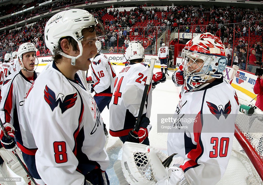 <a gi-track='captionPersonalityLinkClicked' href=/galleries/search?phrase=Alexander+Ovechkin&family=editorial&specificpeople=184488 ng-click='$event.stopPropagation()'>Alexander Ovechkin</a> #8 of the Washington Capitals celebrates a 3-2 victory over the Carolina Hurricanes with goaltender <a gi-track='captionPersonalityLinkClicked' href=/galleries/search?phrase=Michal+Neuvirth&family=editorial&specificpeople=3205600 ng-click='$event.stopPropagation()'>Michal Neuvirth</a> #30 at PNC Arena on March 14, 2013 in Raleigh, North Carolina. Ovechkin recorded his 700th point in the victory.