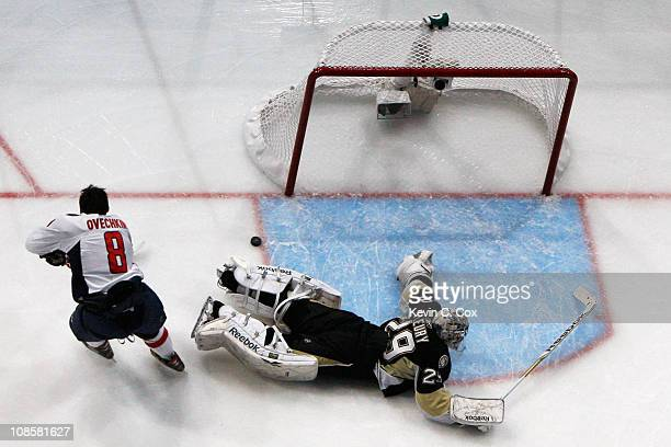Alexander Ovechkin of the Washington Capitals competes against MarcAndre Fleury of the Pittsburgh Penguins on his way to winning the breakaway...