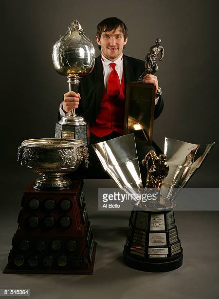 Alexander Ovechkin of the Washington Capitals poses with the Hart Memorial Trophy the Lester B Pearson Award the Art Ross Trophy and the Maurice...