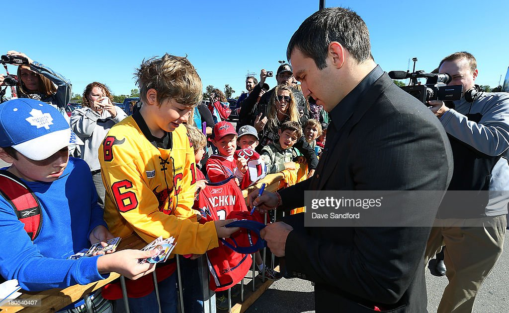 Alexander Ovechkin #8 of the Washington Capitals signs autographs for fans at Yardman arena during Kraft Hockeyville Day 2 on September 14, 2013 in Belleville, Ontario, Canada.