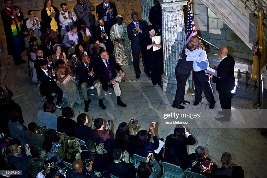 Alexander Padilla and Anthony Arenas hug each other after being married by Newark Mayor and newly-elected U.S. Senator <a gi-track='captionPersonalityLinkClicked' href=/galleries/search?phrase=Cory+Booker&family=editorial&specificpeople=638070 ng-click='$event.stopPropagation()'>Cory Booker</a> at City Hall in the early morning hours of October 21, 2013 in Newark, New Jersey. Same-sex couples were allowed to legally wed at 12:01 am on Monday across New Jersey, making the state the 14th to allow same-sex marriages. Following Friday's ruling by the New Jersey Supreme Court, Mayor Cory A. Booker will marry seven gay, lesbian, and straight couples at City Hall in Newark on Monday morning.