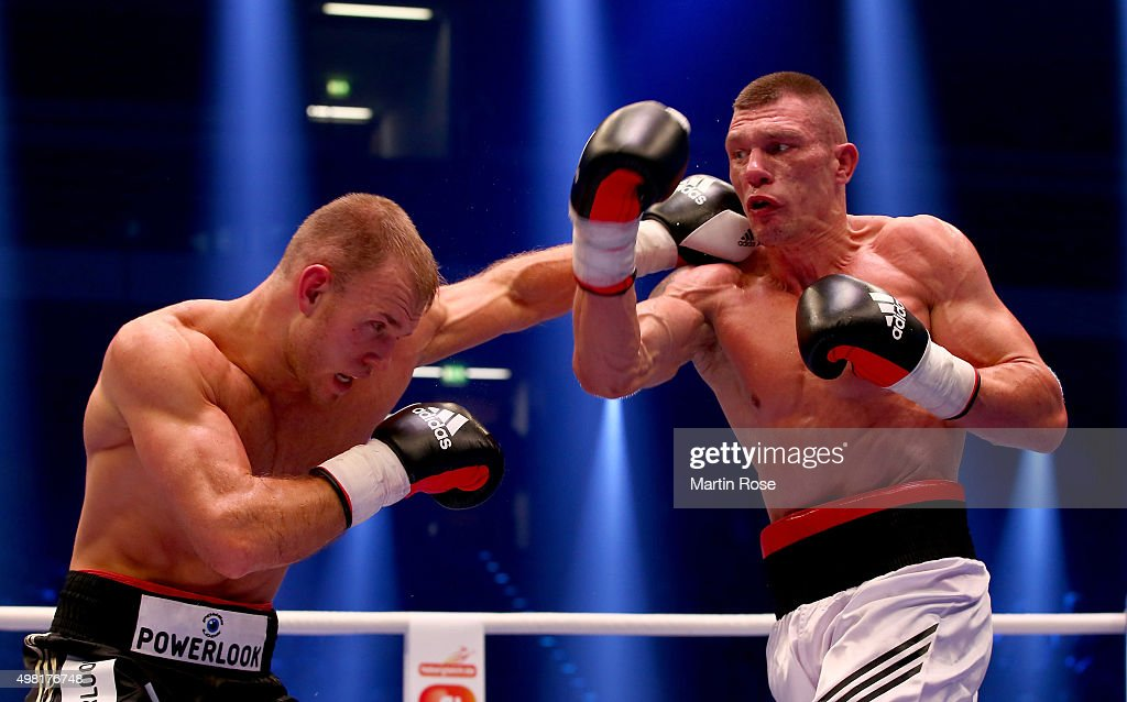 Alexander Peil of Germany exchange punches with Lukasz Zygmunt of Poland during their cruiser weight fight at TUI Arena on November 21 2015 in...