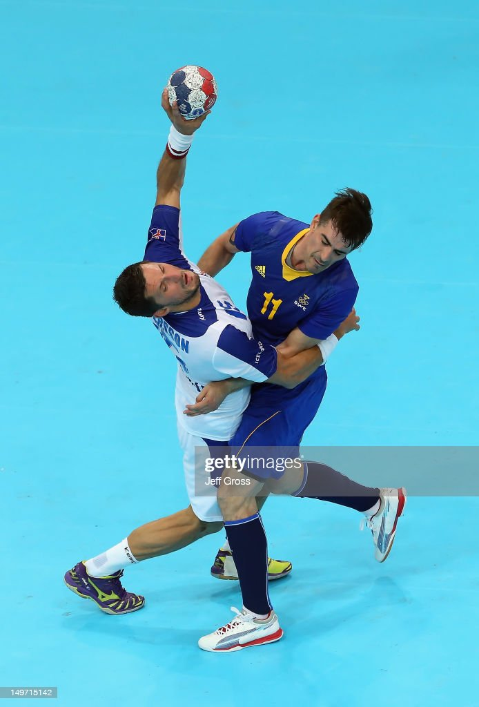 Alexander Petersson (L) #15 of Iceland and Dalibor Doder #11 of Sweden collide in the Men's Preliminaries Group A match between Sweden and Iceland on Day 6 of the London 2012 Olympic Games at The Copper Box on August 2, 2012 in London, England.